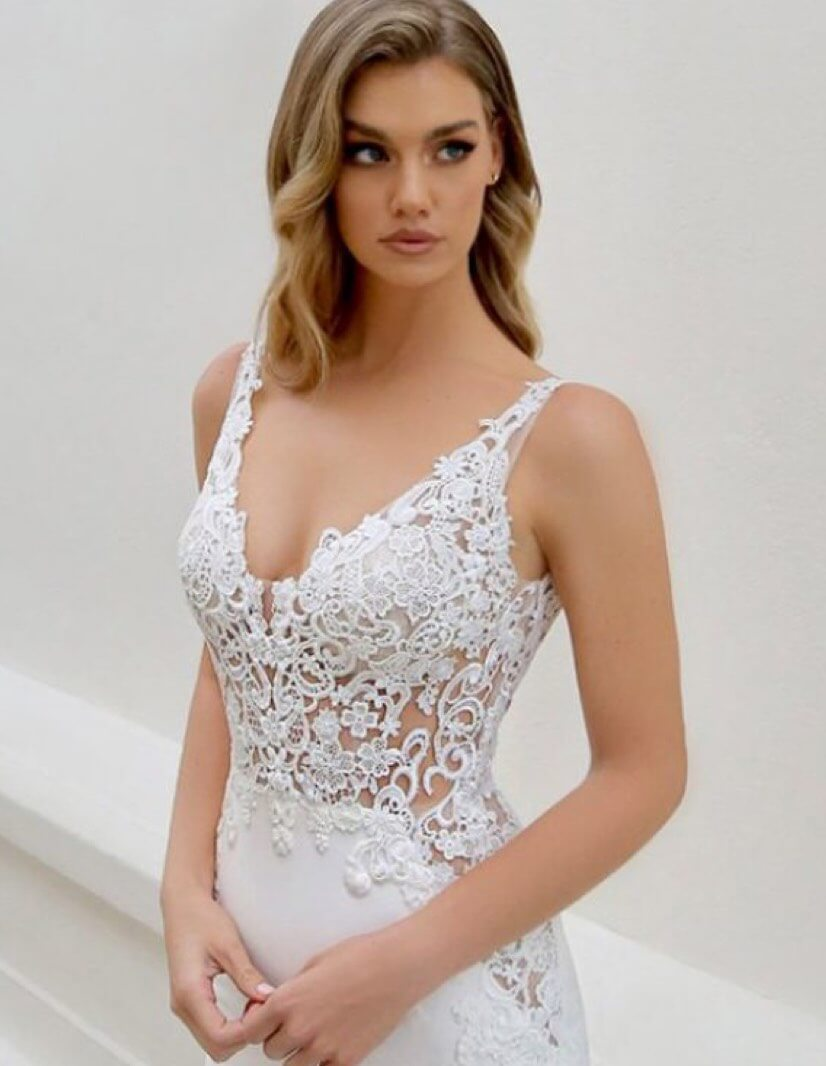 Model wearing a white Blue by Enzoani bridal gown