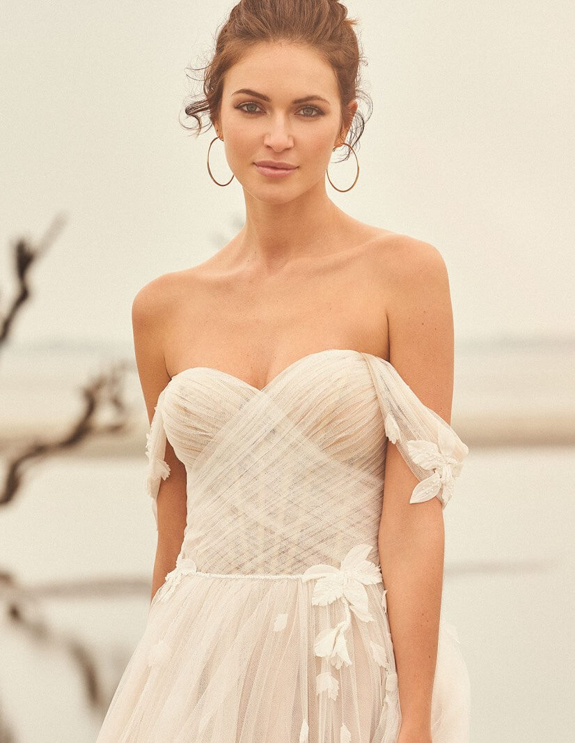 Model wearing a white Lillian West bridal gown